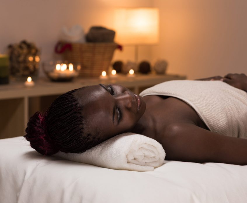 Spa African Woman in Beauty Salon Relaxing